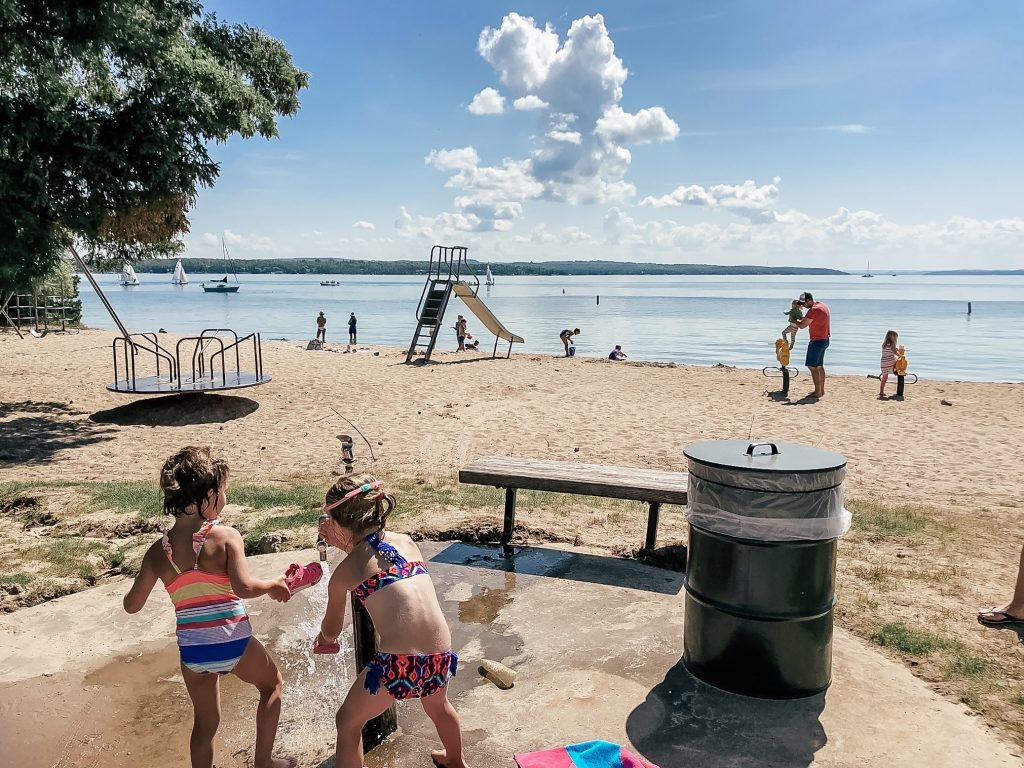 kids playing and swimming at Depot Beach in Charlevoix Michigan
